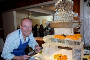 This three tiered ice carving can serve fruit or seafood.