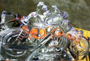 Motorcycle ice carving with shots luge.